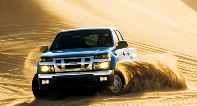 Isuzu i-series pickup playing in the sand