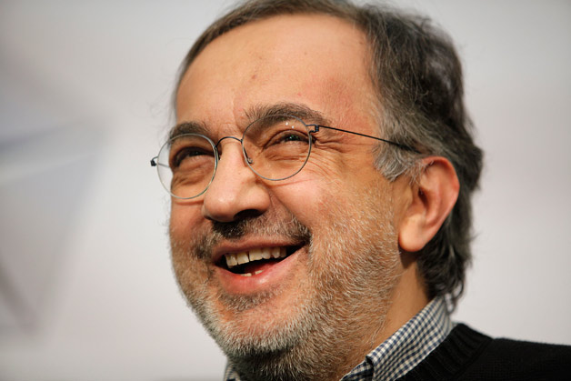Fiat CEO Sergio Marchionne cracks a smile in his trademark sweater