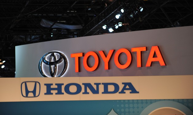 Toyota and Honda auto show signs overlapping