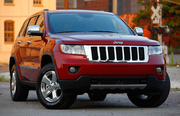 2013 Jeep Grand Cherokee - front three-quarter view - red