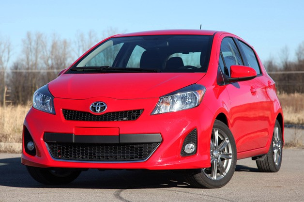 2012 Toyota Yaris liftback - red - front three-quarter view