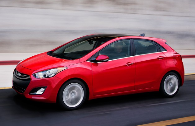 2013 Hyundai Elantra GT - red - front three-quarter dynamic view