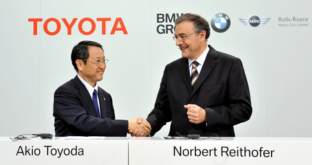 Toyota's Akio Toyoda shakes with BMW's Norbert Reithofer
