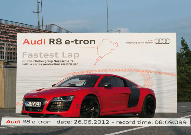 Audi R8 E-tron at Nurburgring in front of record lap time billboard