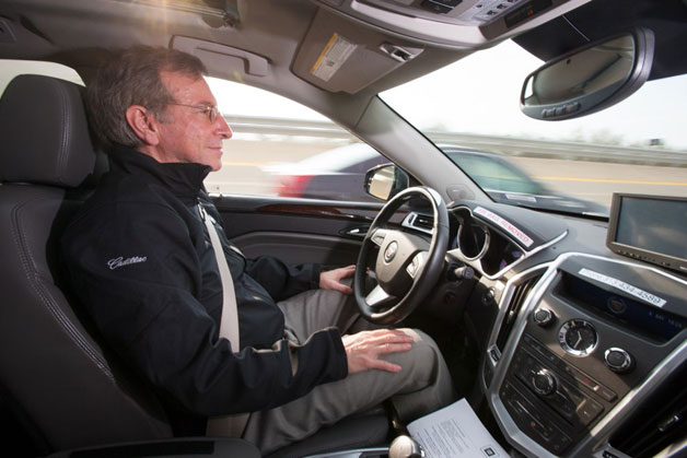 Cadillac test driver in autonomous vehicle