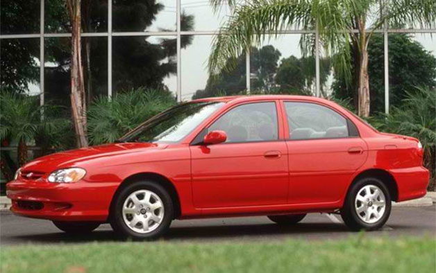 2000 Kia Sephia - Red, front three-quarter view with palm trees