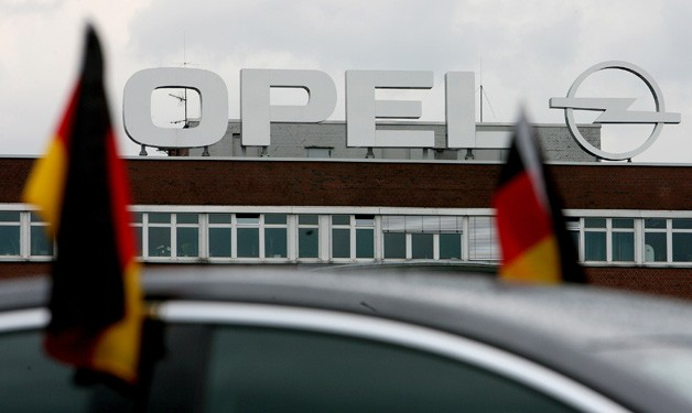 General Motors' Opel division building sign with German flags
