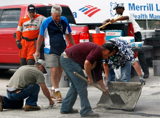 Workers pouring concrete at the 2012 Detroit Belle Isle Grand Prix