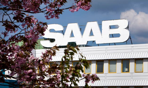 Saab headquarters sign with flowering tree