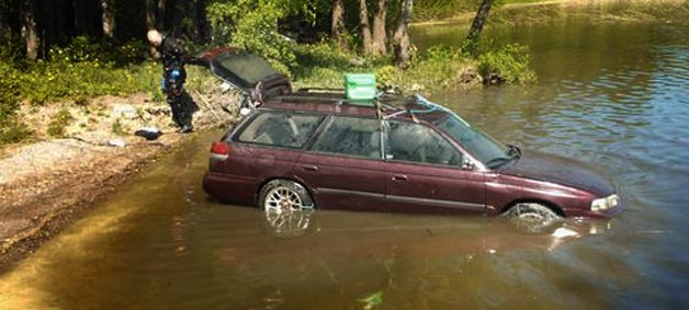 subaru legacy wagon in lake