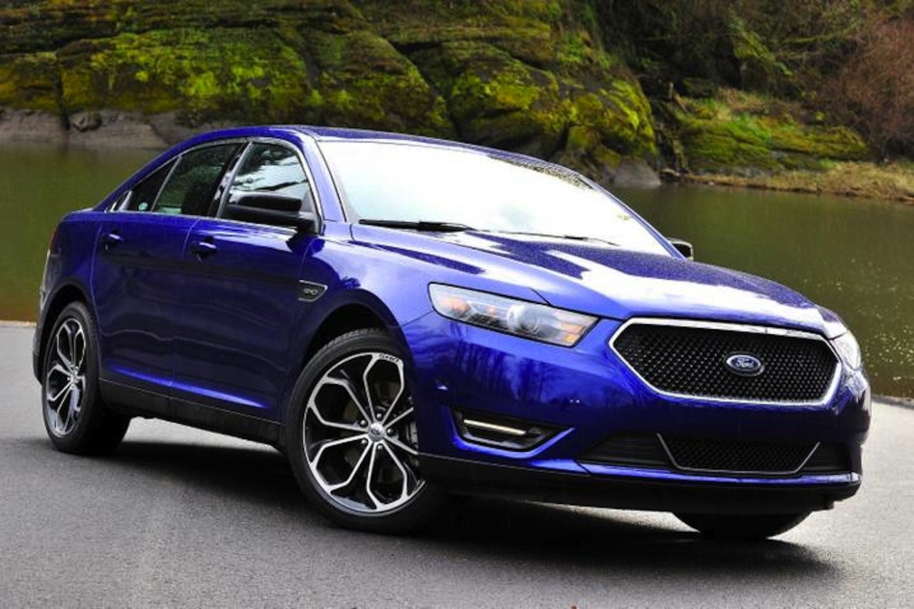 2013 Ford Taurus - blue - front three-quarter view