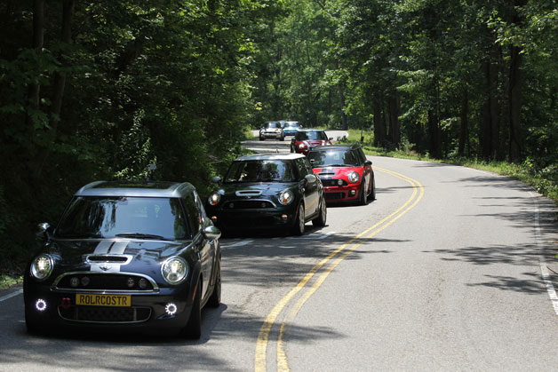 Line of Mini Coopers tackle Tail of the Dragon
