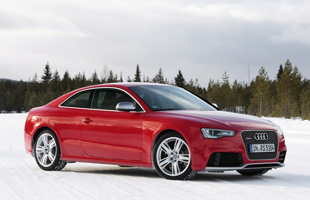2013 Audi RS5 - red - three-quarter view in the snow