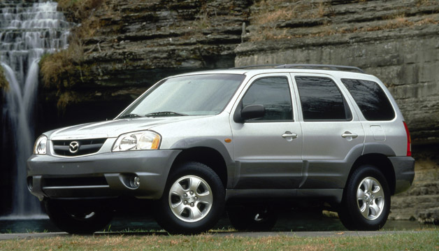 2002 Mazda Tribute - silver - front three-quarter view with waterfall