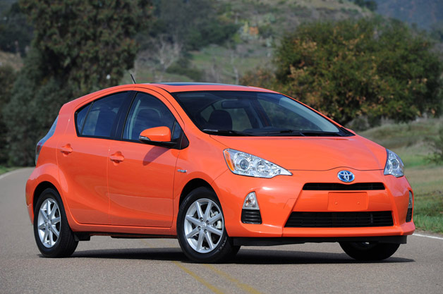 2013 Toyota Prius C - front three-quarter view - orange