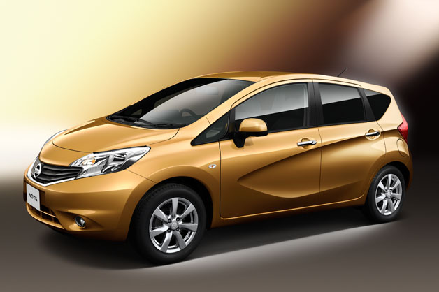 2013 Nissan Note - front three-quarter view in orange/copper hue