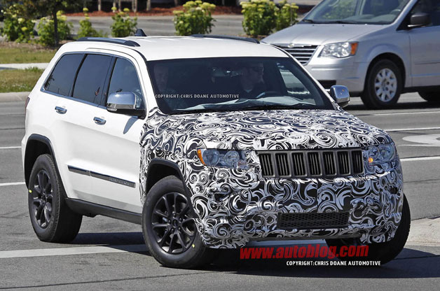 2014 Jeep Grand Cherokee prototype - white - front three-quarter view with nose camouflage