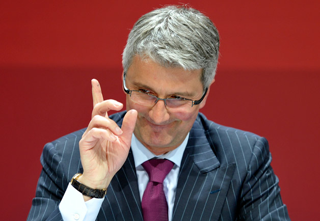 Audi CEO Rupert Stadler points in air during press conference