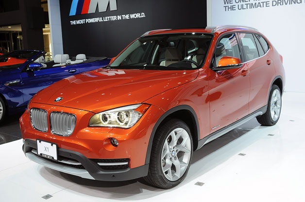 2013 BMW X1 - front three-quarter view, copper, live intro at 2012 NY Auto Show