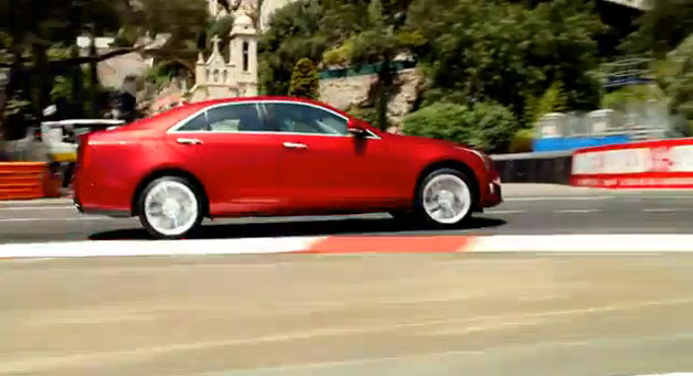 Maroon 2013 Cadillac ATS on track at speed
