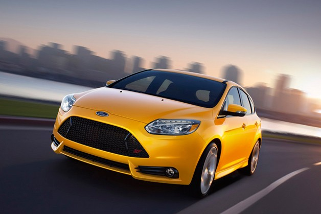 2013 Ford Focus ST - yellow - front three-quarter view, dynamic