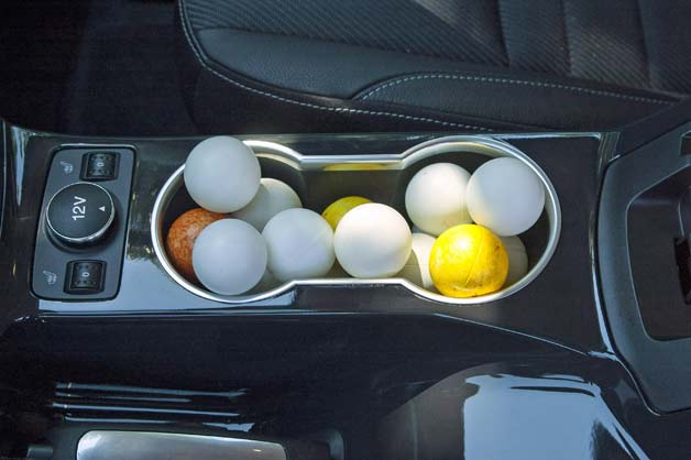 ford escape interior with ping pong balls in the cupholder