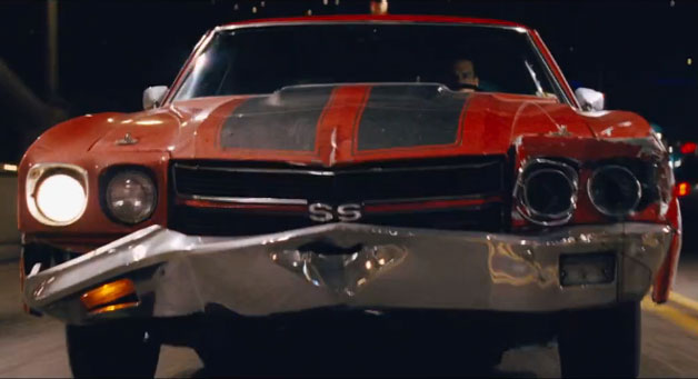 Tom Cruise as Jack Reacher in busted-up Chevrolet Chevelle SS