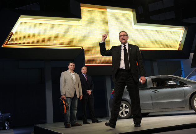 Former GM marketing boss Joel Ewanick on stage with Chevrolet Volt