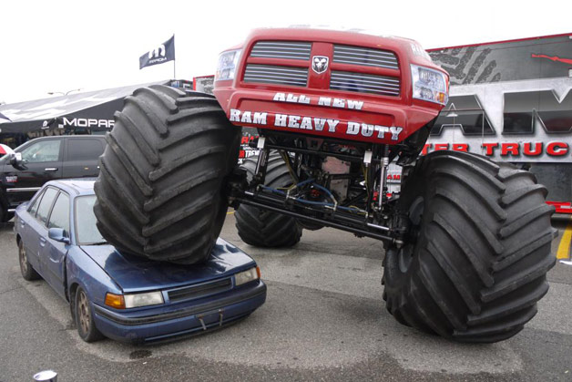 Ram-bodied monster truck crushing Mazda