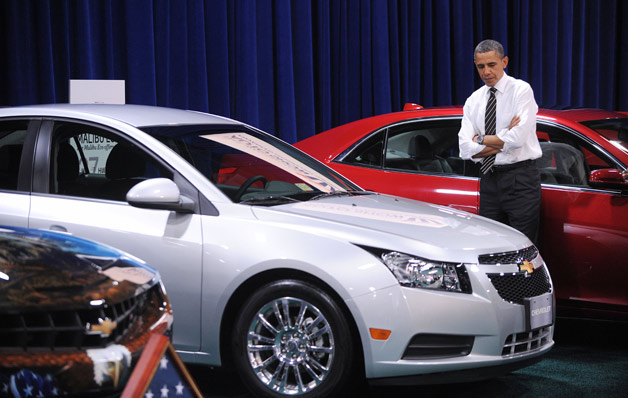 President Barack Obama ponders the Chevrolet Cruze at DC Auto Show