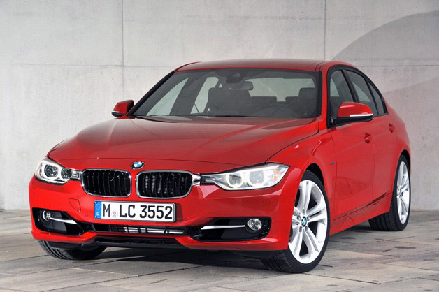 2012 BMW 3 Series - red - front three-quarter view