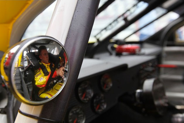 AJ Allmendinger pictured through his side view mirror
