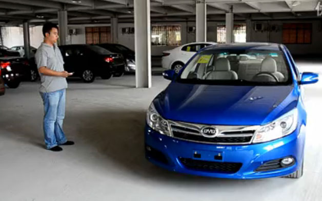 Screencap of video where operator is using remote control to drive BYD car