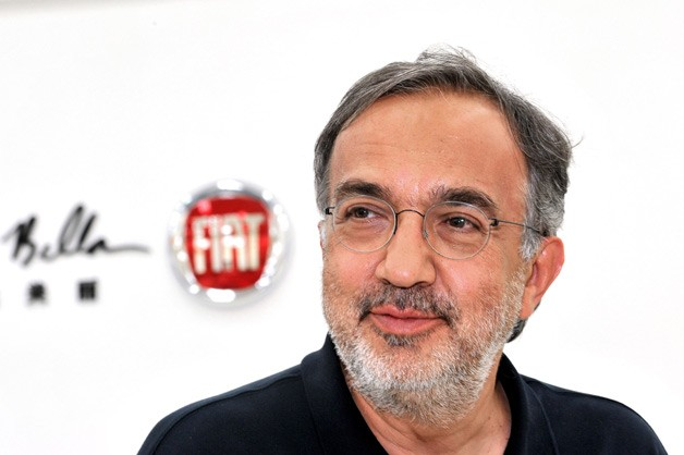Fiat boss Sergio Marchionne in front of Fiat emblem