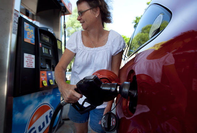 Woman fuels up at a Gulf station