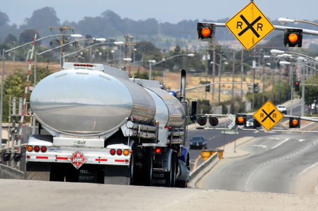 Tanker truck at railroad crossing