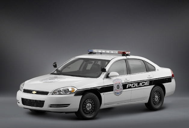 Chevrolet Impala police car in full livery - studio shot - front three-quarter view