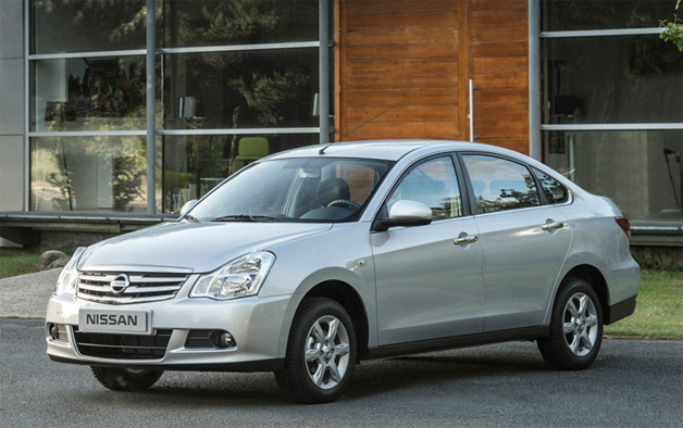 2013 Nissan Almera - Russian market - front three-quarter view, silver