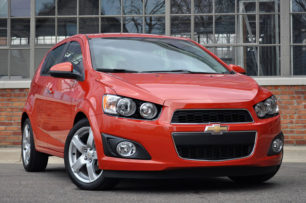 2012 Chevrolet Sonic hatchback - red - front three-quarter view