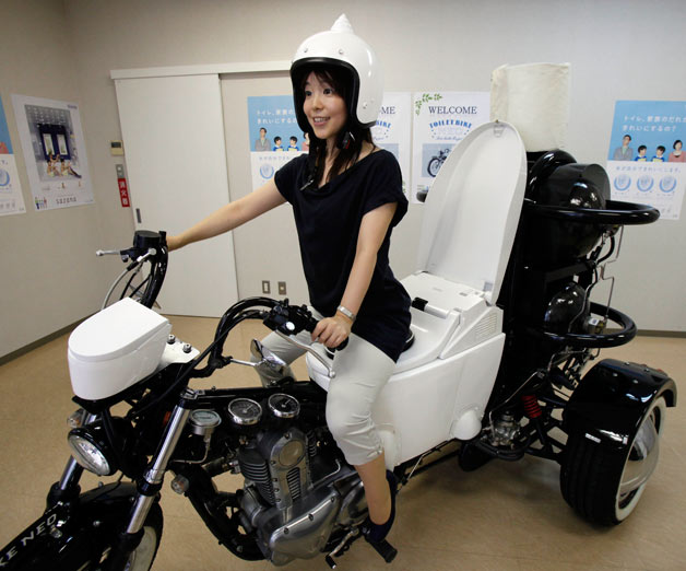 Toto toilet motorcycle with female rider
