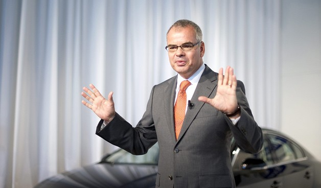 Volvo CEO Stefan Jacoby with hands up at press conference