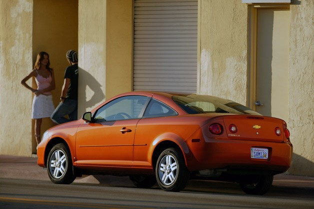 Chevrolet Cobalt Coupe - orange - rear three-quarter view with couple