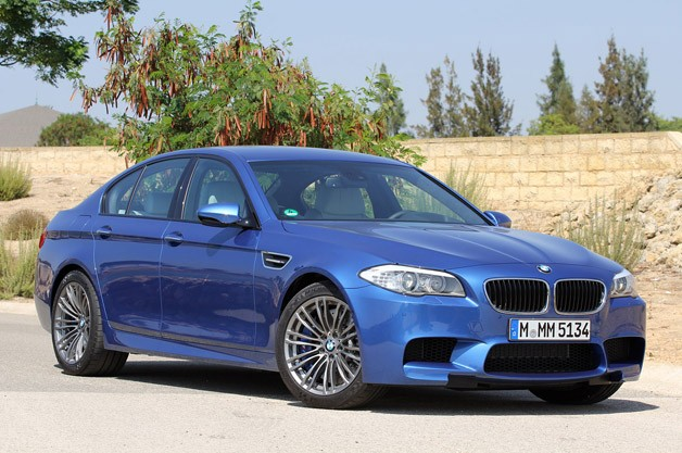 2012 BMW M5 - blue - front three-quarter view