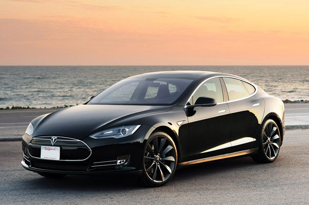 2012 Tesla Model S at sunrise - front three-quarter view, black