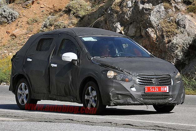 Suzuki SX4 spy shot - camouflaged front three-quarter view