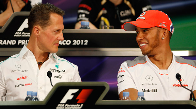 F1 drivers Michael Schumacher and Lewis Hamilton chat during press conference