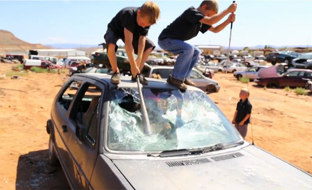 Kids destroy VW GTI in a junkyard - video screencap