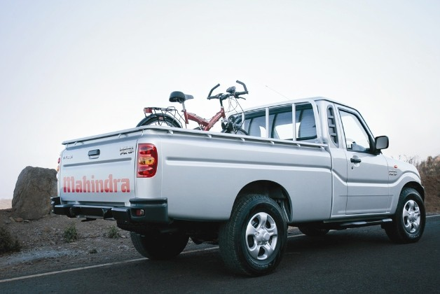 Mahindra Pik-Up with bicycle in bed - rear three-quarter view