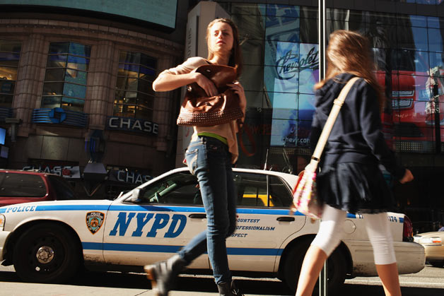NYPD patrol car with Times Square pedestrians