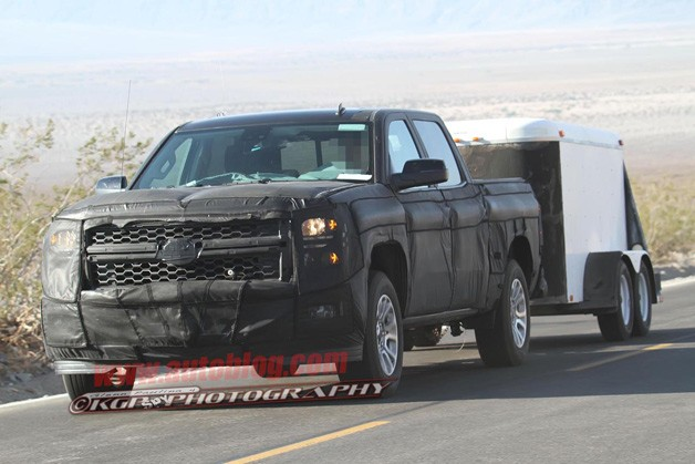 2014 Chevrolet Silverado prototype spy shot - front three-quarter view, towing